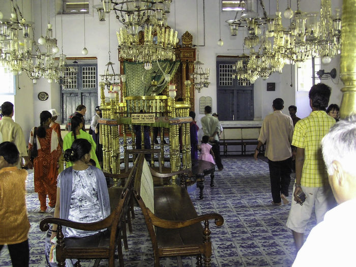 Inside the historic Jewish synagogue in the city of Cochin in Kerala, India. This synagogue is representative of the history of the Jewish presence in India, which has been there for approximately 2000 years now Adult Cochin Cochin Synagogue Indoors  Jewish Temple Kerala Kerala India Men People Real People Synagogue Synagogue In Cochin Women