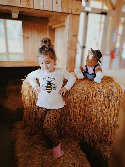 Girl Dancing On Hay Bale At Home