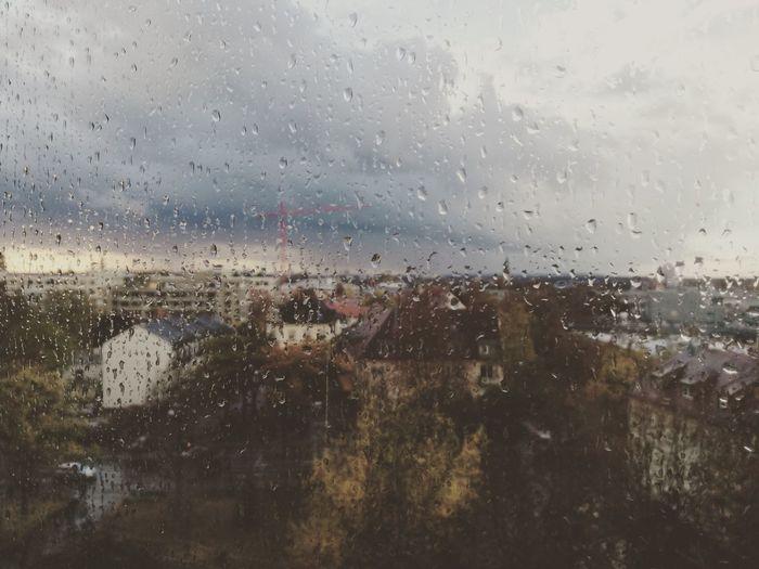 City seen through wet glass window
