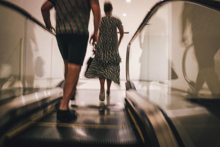 People Moving On Escalator