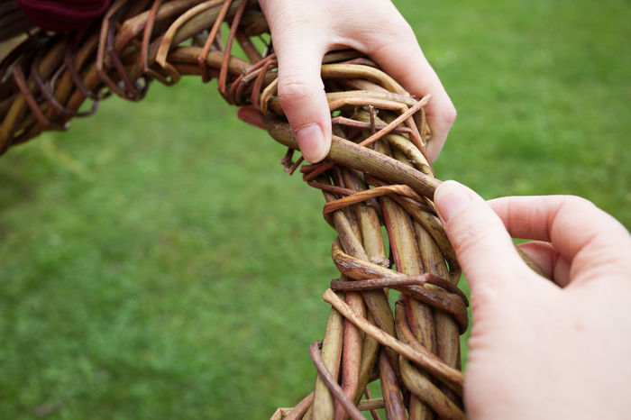 Hands making a wreath Rural Wicker Wickerwork Action Close-up Day Garden Grass Hobby Holding Human Body Part Human Finger Human Hand Nature Outdoors Real People Wattle Wreath Wreathing