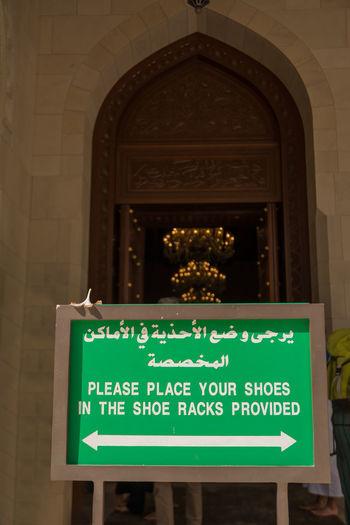 Information sign against building
