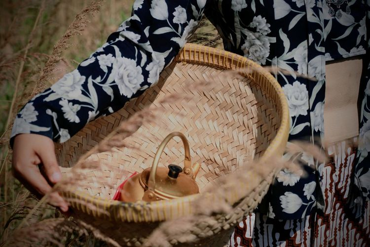 Close-up of woman holding basket