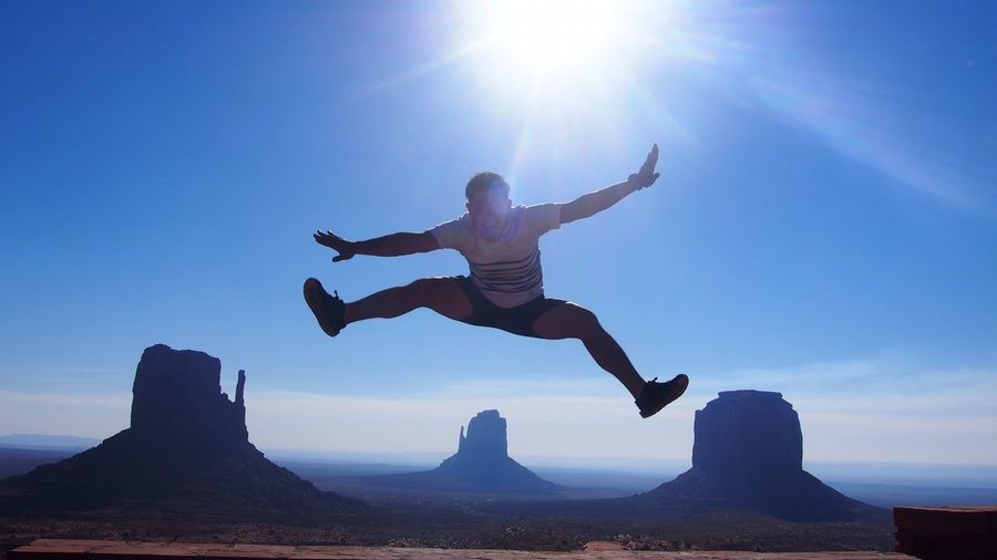 One Person Vitality Full Length Jumping Passion Sunlight Sky Adventure Outdoors