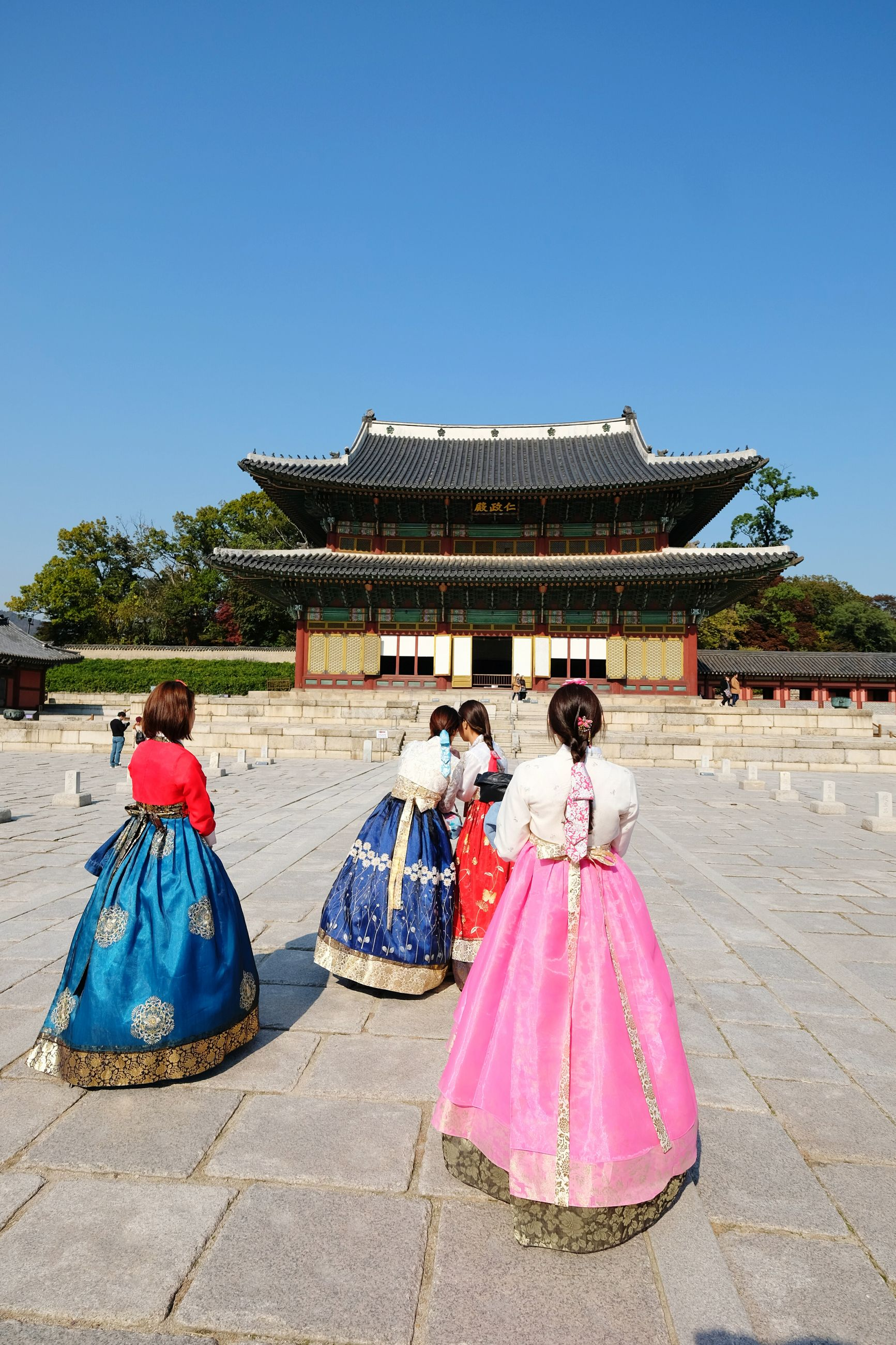 blue, clear sky, built structure, architecture, tradition, outdoors, day, spirituality, traditional clothing, building exterior, real people, tree