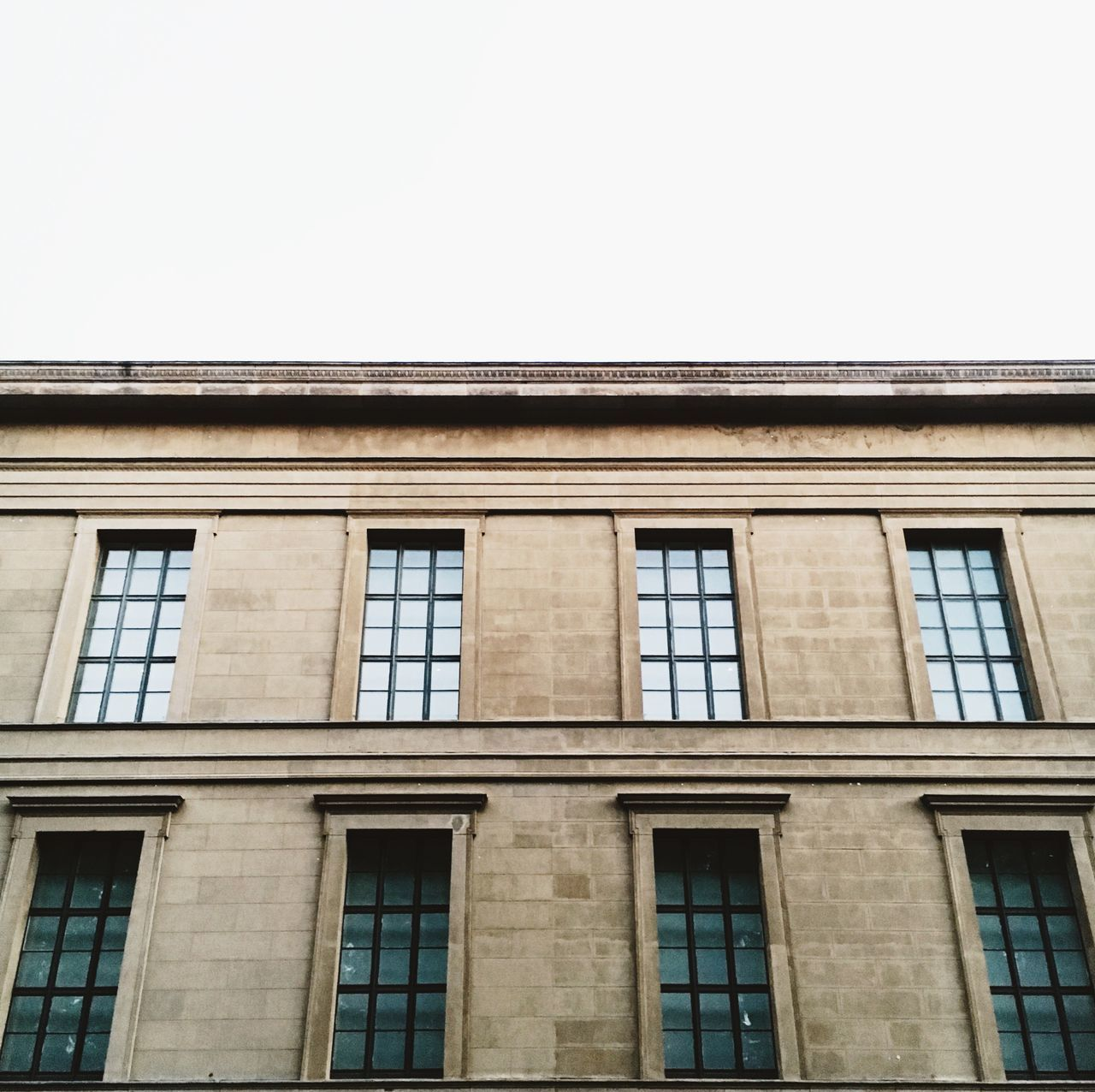 architecture, building exterior, built structure, low angle view, window, day, clear sky, no people, outdoors, sky