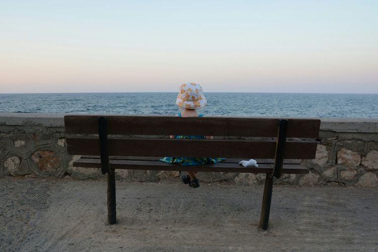 Childhood Family Holiday Mediterranean  Crete Greece Meditative Slow Parenting Sea Bench Cute Summer Hat