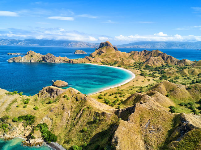 Aerial view of a small bay and hills on Pulau Padar island in between Komodo and Rinca Islands near Labuan Bajo in Indonesia. DJI X Eyeem DJI Mavic Pro Dragon Flores Island INDONESIA National Park Tourist Travel Travel Photography Aerial Aerial Photography Aerial View Destination Dji East Nusa Tenggara Flores Komodo Labuan Bajo Landscape Padar Pulau Rinca Tourism Tropical Vacation