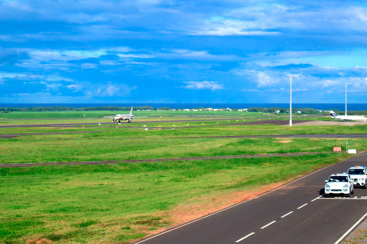 Beauty In Nature Car Cloud - Sky Day Field Grass Green Color Landscape Mauritius Airport Mauritius Island  Mode Of Transport Nature No People Outdoors Road Rural Scene Scenics Sky Transportation Travel