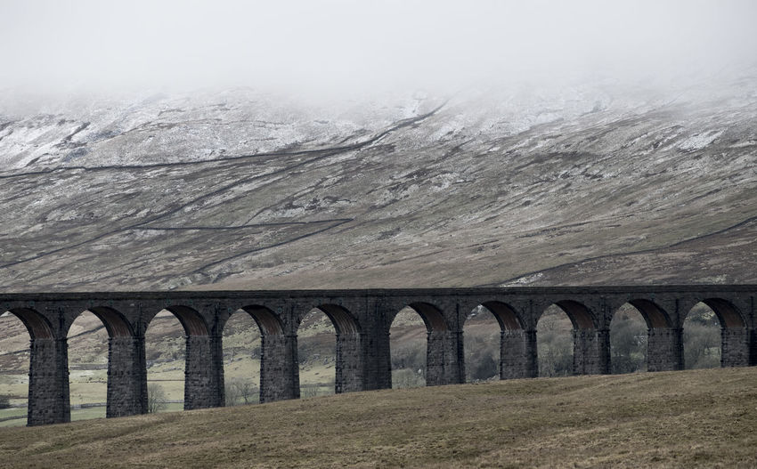 Winter Arch Architecture Bridge - Man Made Structure Built Structure Fog Mountain Nature No People Outdoors Ribblehead Viaduct Scenics Snow