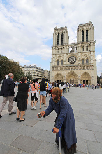Notre Dame is one of the largest and most well-known churches in the world Architecture Blue Sky Cathedral France Gargoyle Gothic Gothic Architecture Historical Building Landmark Notre Dame De Paris Notre-Dame Paris Tourist Attraction  Tourists White Clouds