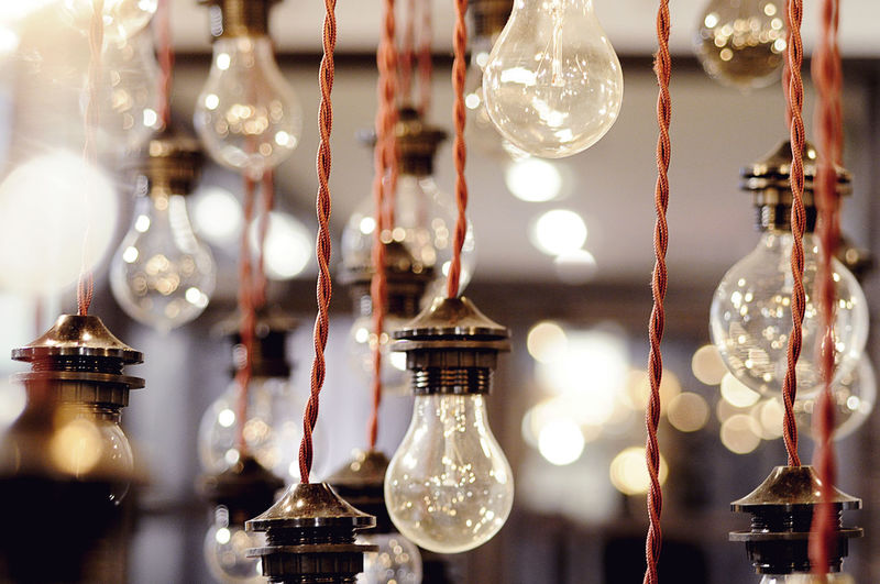 Lights Glow Shallow Depth Of Field Creative Light Fixture Fixture Bright Canon Focus On Foreground Shallow Depth Of Field Bulbs Picoftheday Screensaver Red Filament Bulb Filament Hanging Lights Hanging Light Lightbulb Bulb Showroom Bokeh Photography Bokeh