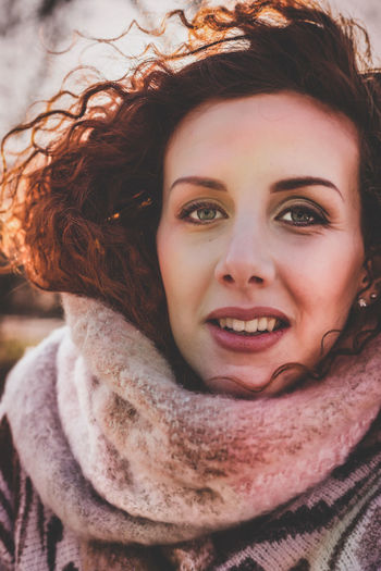 Close-Up Portrait Of Redhead Woman In Warm Clothing