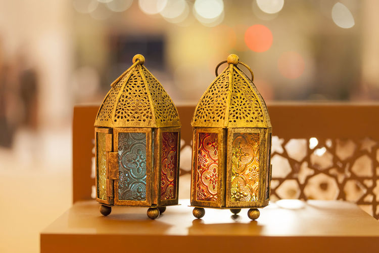 Traditional arabic lanterns lit up in Ramadan, Eid, Diwali Eid Mubarak Lantern Ramadan  Ramadan Mubarak Art And Craft Close-up Container Craft Creativity Decoration Design Eid Electric Lamp Floral Pattern Focus On Foreground Food And Drink Illuminated Indoors  Lighting Equipment No People Pattern Selective Focus Shape Still Life Table