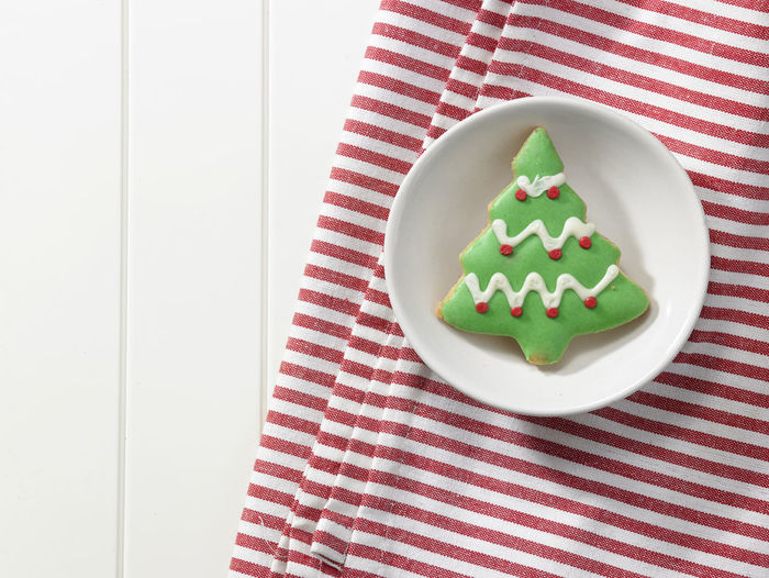High Angle View Of Cookies In Plate With Napkin On Table