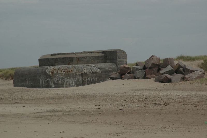 """Remains of the """"Atlantic Wall"""" at the beach in Denmark. These Bunkers remain at the beach after having been abandoned at the end of WW2 Bunker Nature WW2 Leftovers Beach Beauty In Nature Clear Sky Day Desert Fortress Landscape Nature No People Outdoors Sand Sky Stronghold Tranquility Ww2"""