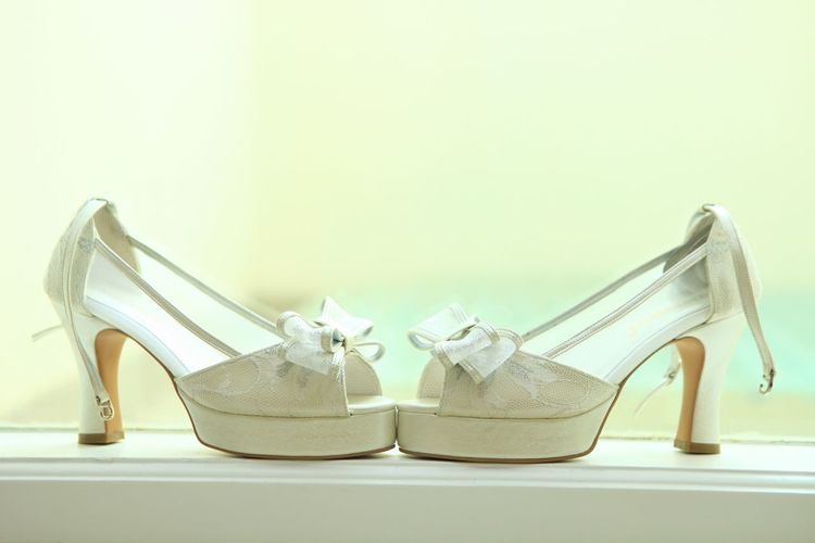 A pair of bride's shoes Shoe Still Life High Heels Indoors  Pair No People Close-up Two Objects Fashion Womenswear Personal Accessory Side By Side