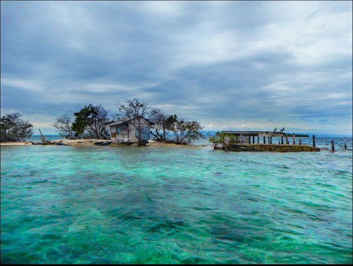 fishing hut where local commercial fisherman stay Cloud - Sky Distant Fishing Hut, Local Commercial Fisherman House Outdoors Tropical Climate Water Waterfront Work, Making A Living
