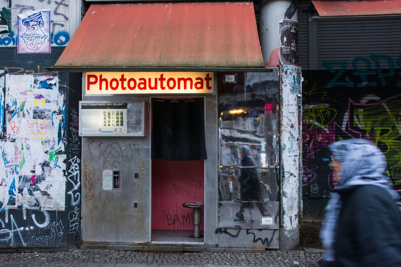 Photoautomat Architecture Building Exterior Built Structure City Communication Day One Person Outdoors People Real People Store Text