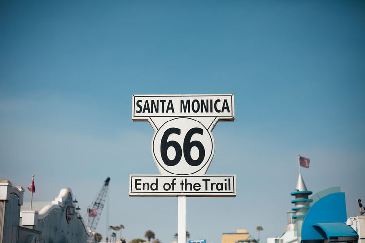 Low Angle View Of Road Sign At Santa Monica Pier Against Clear Sky
