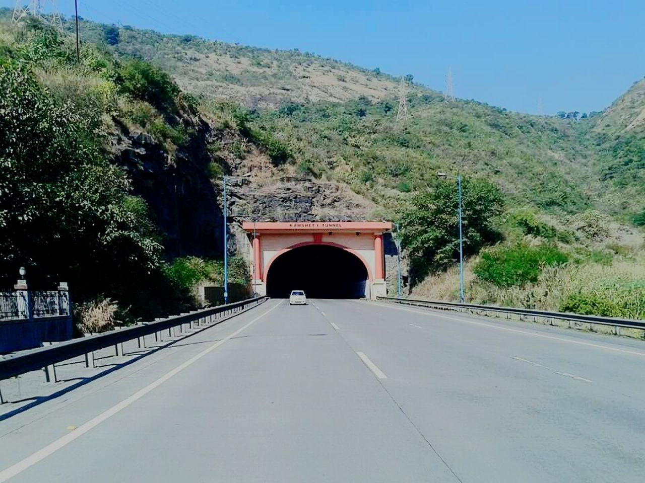 bridge - man made structure, architecture, transportation, built structure, connection, tree, road, the way forward, day, tunnel, outdoors, no people, bridge, mountain, covered bridge, clear sky, nature, sky