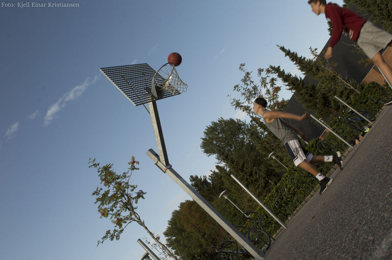 Aim for pro! Basketball - Sport Basketball Hoop Boys Childhood Day Full Length Jumping Leisure Activity Lifestyles Low Angle View Men Motion Nature One Person Outdoors People Playing Real People Sky Sport Tree The Week On EyeEm The Street Photographer - 2018 EyeEm Awards
