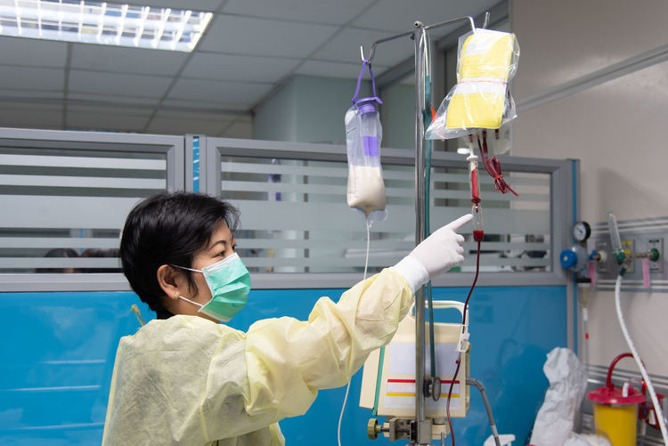 Side view of doctor working in hospital