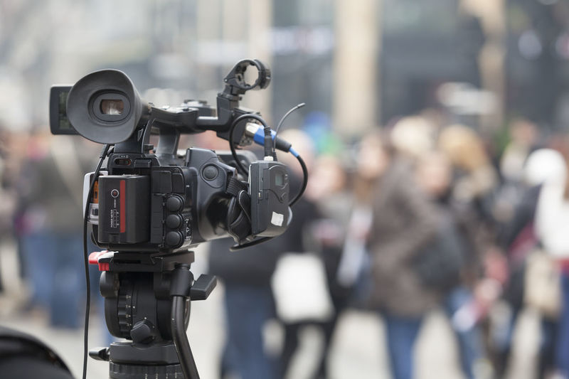 Television camera with people in background