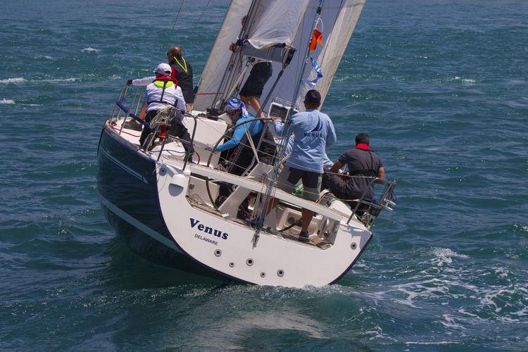 Men sailing a yacht on sea
