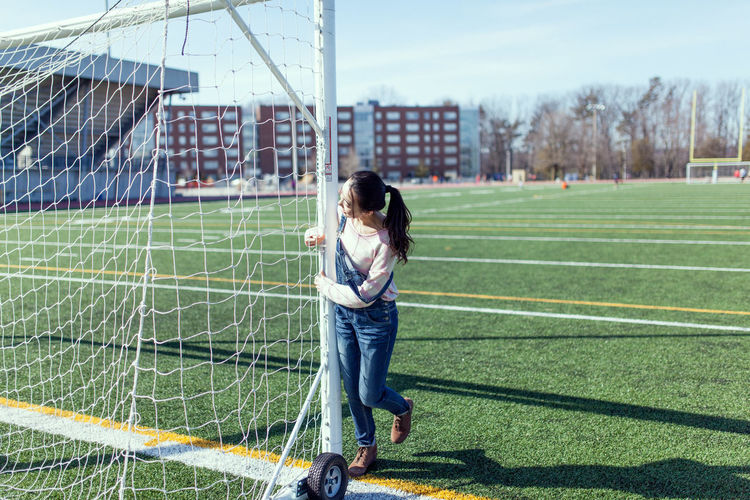 Woman with soccer goal