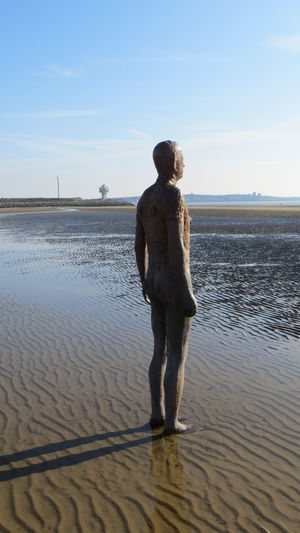 Statue Ankle Deep In Water Another Place By Anthony Gormley Beach Beauty In Nature Day Full Length Horizon Over Water Leisure Activity Lifestyles Men Nature Outdoors Sand Scenics Sea Sky Standing Tranquil Scene Tranquility Water