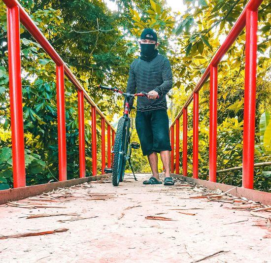 Full length of man standing on footbridge in playground