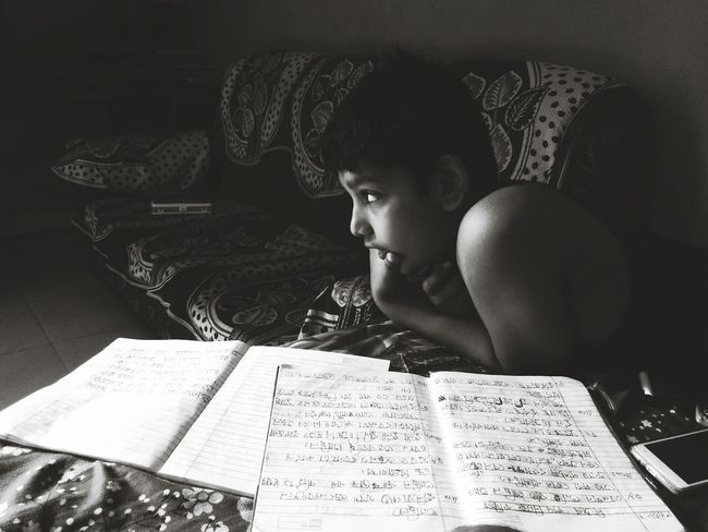 Deep thought Reading One Person Children Only Indoors  Child Learning People Concentration Day Shadow Mobilephotography Redmi2Prime BYOPaper!