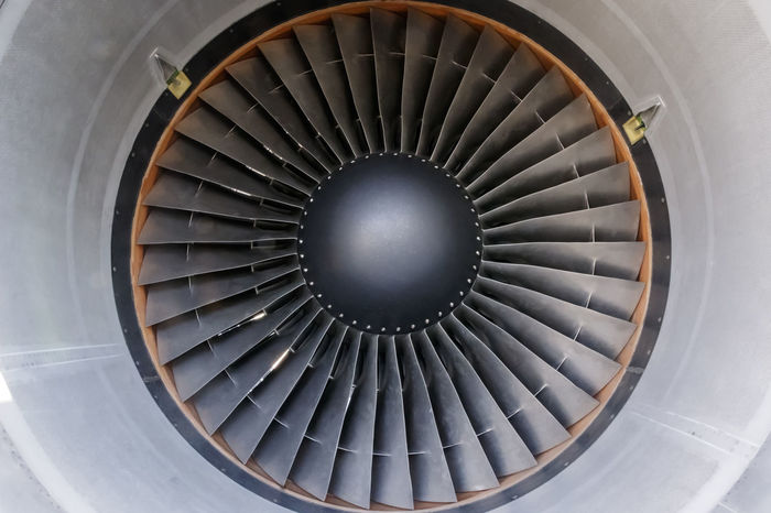 Close-up of a jet engine's blades Aircraft Airplane Backgrounds Circle Close-up Engine Full Frame Geometric Shape Jet Low Angle View Modern No People Propulsion Repetition Shape Spiral Thrust Turbo Vanes