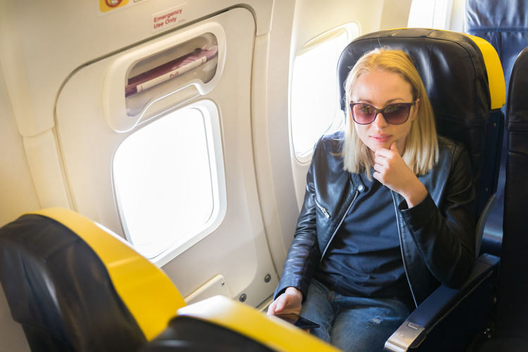 Portrait of woman sitting in airplane
