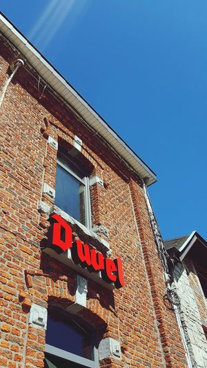 Low Angle View Outdoors Roof Day No People Sky Duvel Beer Drink Logo Building Exterior