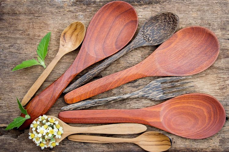 Directly above of wooden spoons on table
