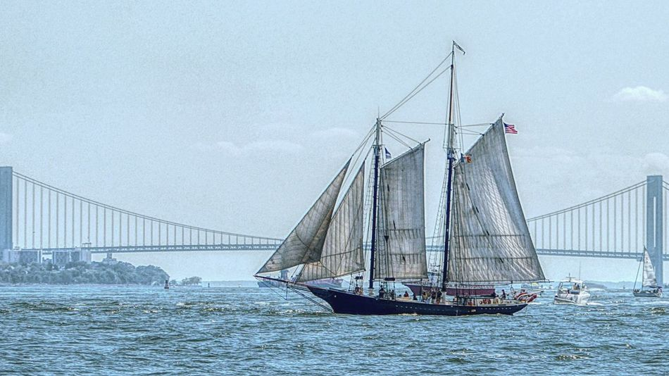 New York Hudson River Waterfront Transportation Water Nautical Vessel Sea Sky Mode Of Transport Blue Engineering Day Calm Nature Outdoors Scenics Tranquility Suspension Bridge Ocean Large Tranquil Scene Long Sailing Ship Sail Away, Sail Away Ship In Front Of Bridge