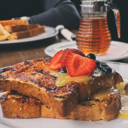 Close-Up Of French Toasts Served In Plate On Table