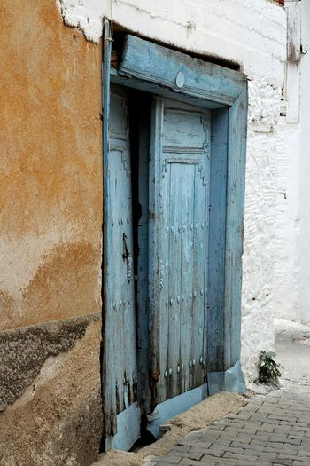 Old closed door of house