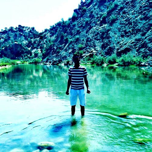summer vacation in moroccan town Rear View Water Reflection One Person Full Length Real People Nature Lake Beauty In Nature Day Outdoors Tree Lifestyles Standing Oar Leisure Activity Scenics People