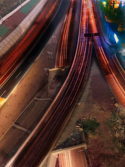 High angle view of light trails on railroad track
