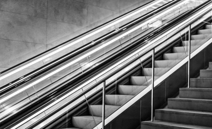 Architecture Black & White Black And White Built Structure Day Diagonal Escalator EyeEm Best Edits EyeEmBestPics Indoors  Lines Minimalism No People Railing Staircase Steps And Staircases Urban Exploration