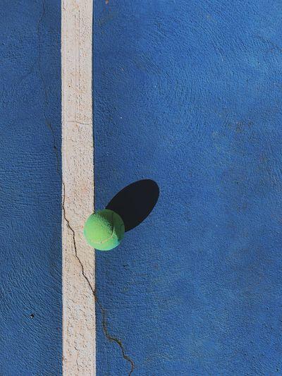 High angle view of blue ball on wall
