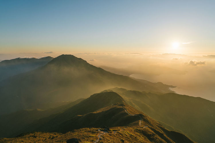 Lantau Peak Sunrise Beauty In Nature Day Fog Landscape Mountain Nature No People Outdoors Scenics Sky Sun Sunbeam Sunlight Sunset Travel