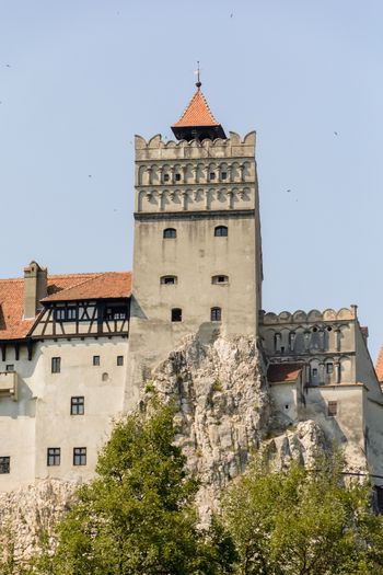 Low Angle View Of Bran Castle Against Clear Sky