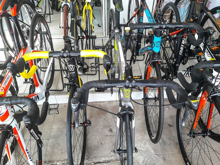 Cycle of life. Bicycle Cycling Mode Of Transport Racing Bicycle Transportation Pedal Land Vehicle Stationary Adults Only Men People Bicycle Shop Outdoors Adult Exercise Bike Day Udon Thani Thailand