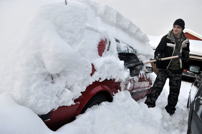 Lapland Sweden Winter Car Cleaning From Snow Cowered Day Full Length Land Vehicle Lifestyles One Person Outdoors People Real People Smiling Snow Warm Clothing Winter Young Adult EyeEm Ready