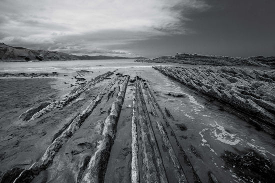 Beach Black And White Diminishing Perspective Landscape Monochrome No People Non-urban Scene Outdoors Remote Scenics Sea Seaside Sky Tide Travel Destinations Water Zumaia