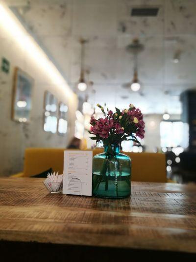 Flower vase on table in restaurant